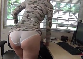 Big-eyed hottie fucked in the office