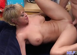 Short-haired MILF gives a passionate bj