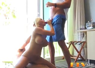 Two horny men are fucking a slutty blonde