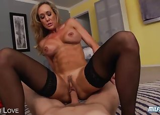 Sporty goddess jumps on a fat young cock