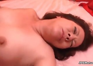 Big-boobed brunette fucked from behind