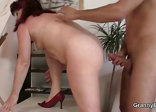 Busty redhead fucked by a young boner